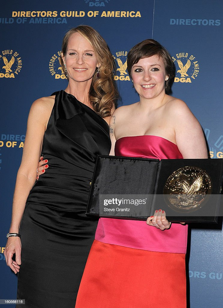 Presenter Helen Hunt (L) and actress/director Lena Dunham, winner of the Outstanding Directorial Achievement in Comedy Series for the 'Girls' pilot episode, pose in the press room at the 65th Annual Directors Guild Of America Awards at The Ray Dolby Ballroom at Hollywood & Highland Center on February 2, 2013 in Hollywood, California.