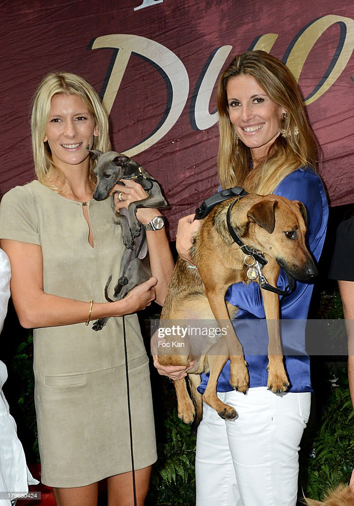 TV presenter Helene Boucher and Miss France 1998 Sophie Thalmann attend the Duo Delice Dog Food Launch Party at 6 Mandel on September 6, 2013 in Paris, France.