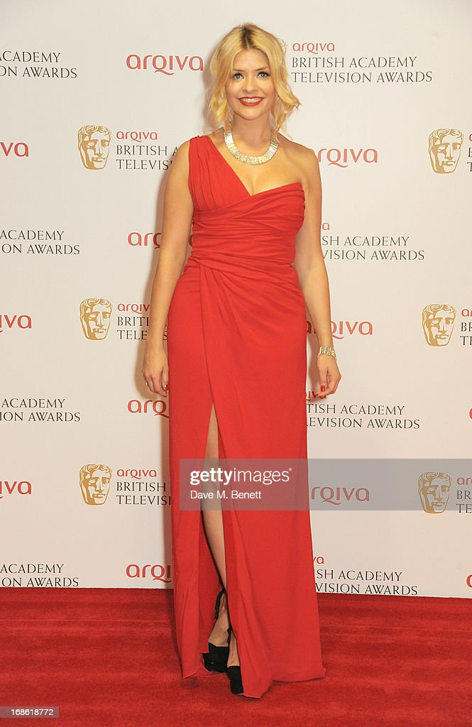 Presenter Holly Willoughby poses in the press room at the Arqiva British Academy Television Awards 2013 at the Royal Festival Hall on May 12, 2013 in London, England.