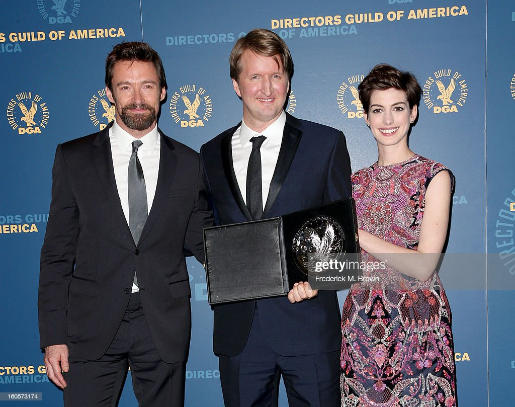 """Presenter Hugh Jackman; director Tom Hooper, recipient of the Feature Film Nomination Plaque for """"Les Miserables'; and presenter Anne Hathaway pose in the press room during the 65th Annual Directors Guild Of America Awards at Ray Dolby Ballroom at Hollywood & Highland on February 2, 2013 in Los Angeles, California."""