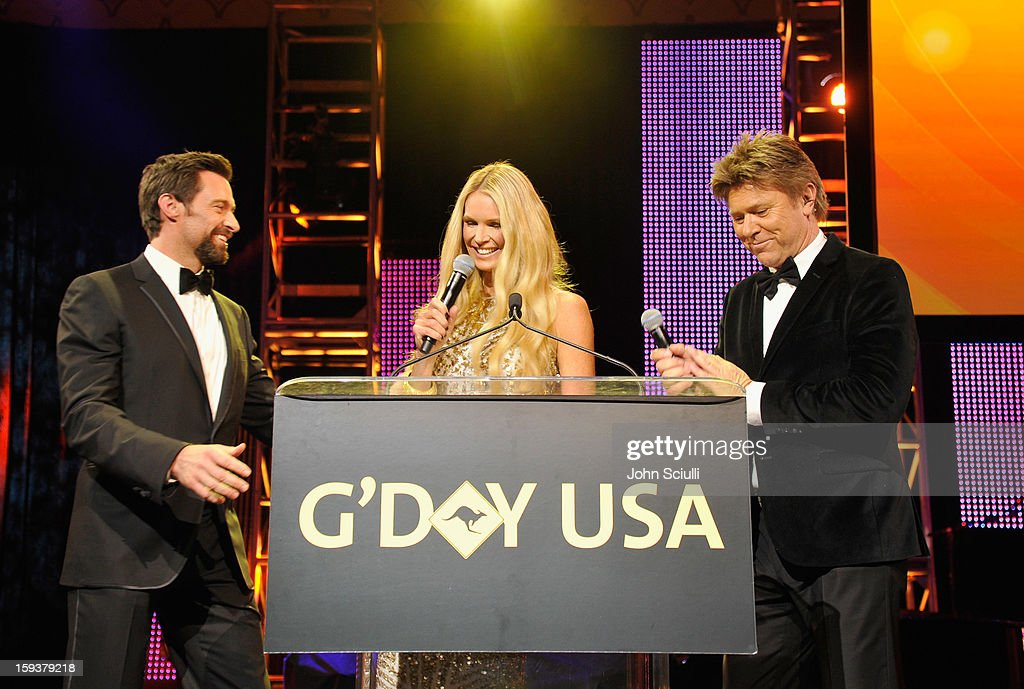 Presenter Hugh Jackman, Masters of Ceremonies Elle Macpherson and Richard Wilkins speak onstage during the 2013 G'Day USA Los Angeles Black Tie Gala at JW Marriott Los Angeles at L.A. LIVE on January 12, 2013 in Los Angeles, California.