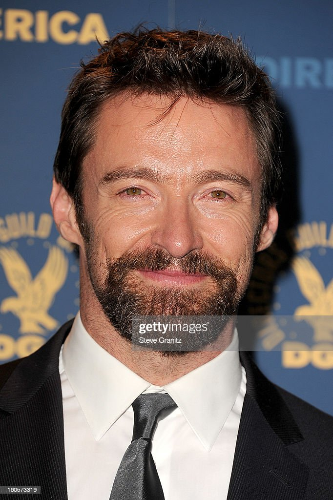 Presenter <a gi-track='captionPersonalityLinkClicked' href=/galleries/search?phrase=Hugh+Jackman&family=editorial&specificpeople=202499 ng-click='$event.stopPropagation()'>Hugh Jackman</a> poses in the press room at the 65th Annual Directors Guild Of America Awards at The Ray Dolby Ballroom at Hollywood & Highland Center on February 2, 2013 in Hollywood, California.
