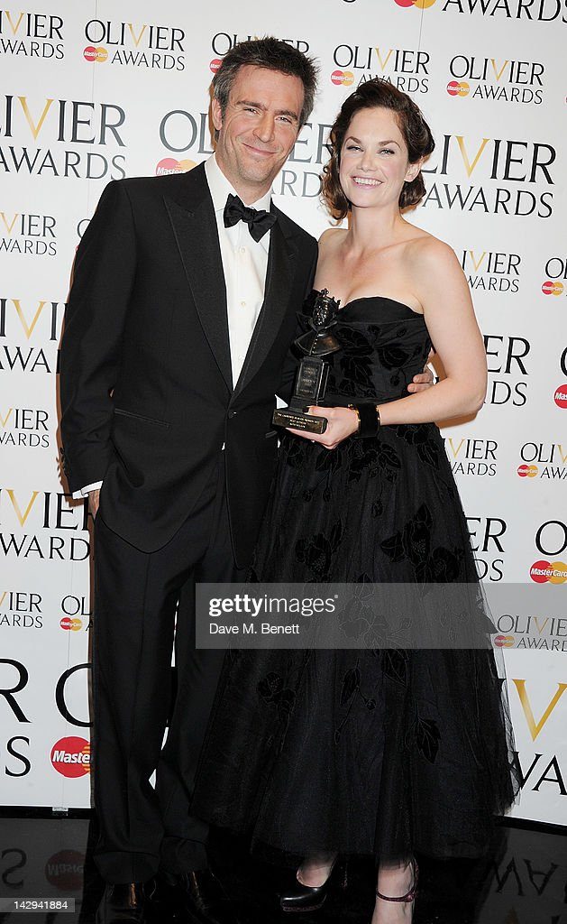 Presenter Jack Davenport and Best Actress winner Ruth Wilson pose in the press room at the 2012 Olivier Awards held at The Royal Opera House on April...