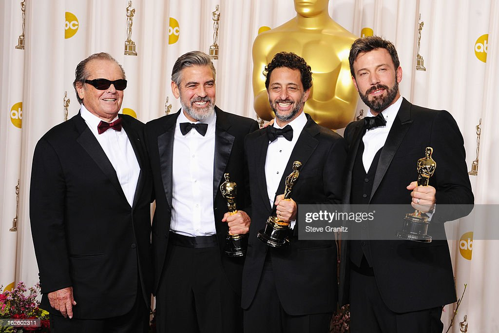 Presenter Jack Nicholson actor/producer George Clooney producer George Clooney and actor/producer Ben Affleck pose in the press room during the...