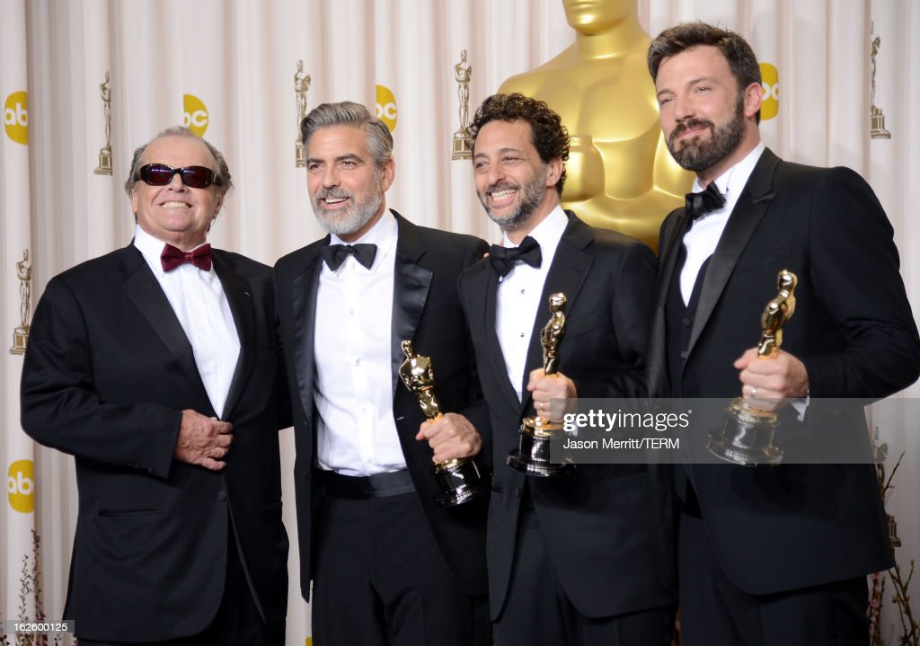 Presenter Jack Nicholson with producers George Clooney and Grant Heslov and actorproducerdirector Ben Affleck winners of the Best Picture award for...