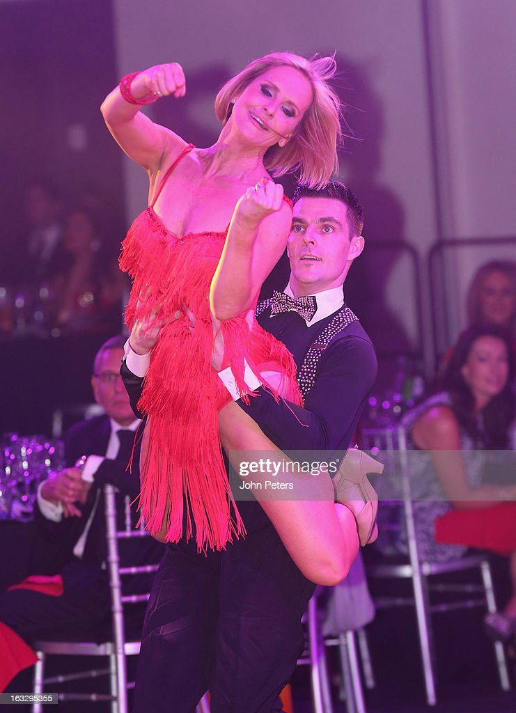 TV presenter Jacquie Beltrao performs a ballroom dancing routine as part of Dancing with United, in aid of the Manchester United Foundation, at Old Trafford on March 7, 2013 in Manchester, England.
