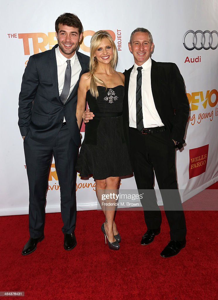 Presenter James Wolk, actress Sarah Michelle Gellar, and Executive Producer and Director Adam Shankman attend 'TrevorLIVE LA' honoring Jane Lynch and Toyota for the Trevor Project at Hollywood Palladium on December 8, 2013 in Hollywood, California.
