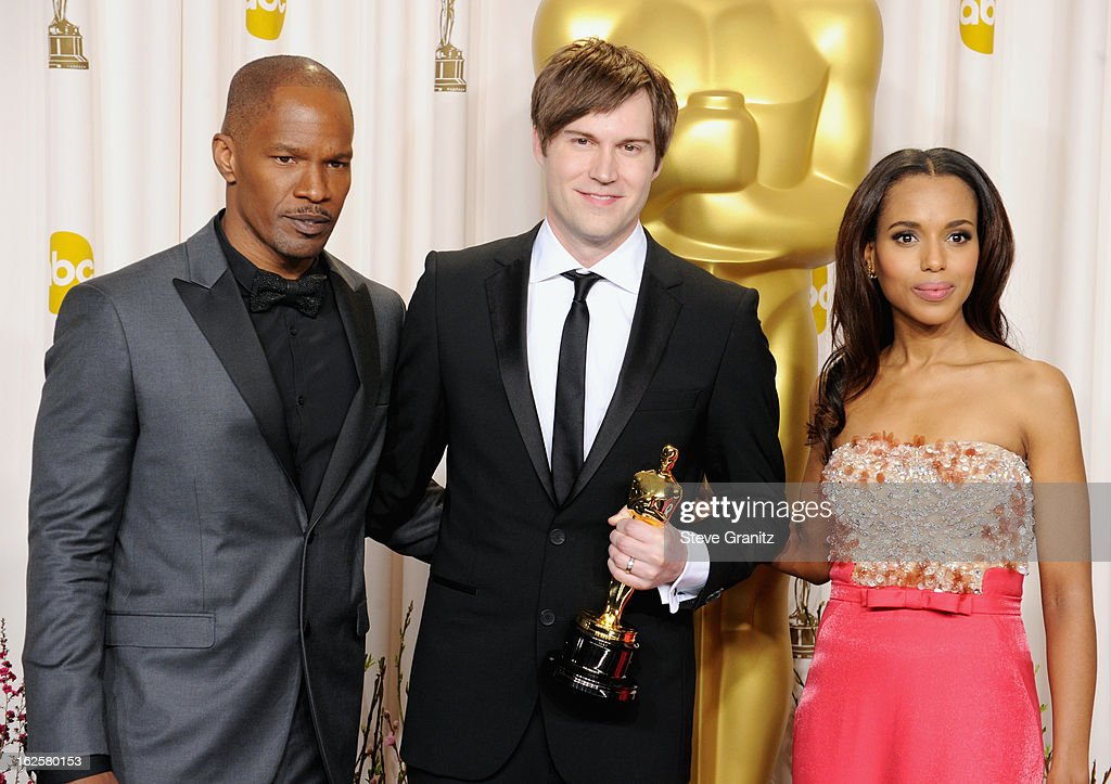 Presenter Jamie Foxx, animator John Kahrs and presenter Kerry Washington pose in the press room during the Oscars at the Loews Hollywood Hotel on February 24, 2013 in Hollywood, California.