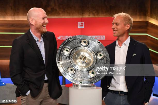 Presenter Jan Henkel and Matthias Sammer laugh while posing for a picture during the Eurosport Bundesliga Media Day on August 16 2017 in Unterfohring...