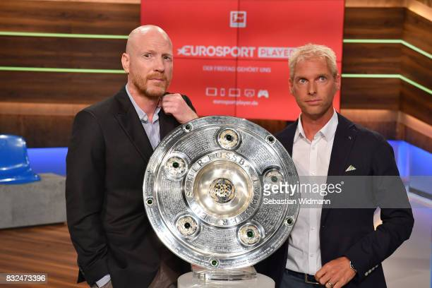 Presenter Jan Henkel and Matthias Sammer pose for a picture during the Eurosport Bundesliga Media Day on August 16 2017 in Unterfohring Germany