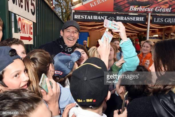 TV presenter Jean Luc Reichmann pose for a selfie with kids during Foire du Trone Auction Launch Party to benefit 'Les Petits Princes' Children Care...