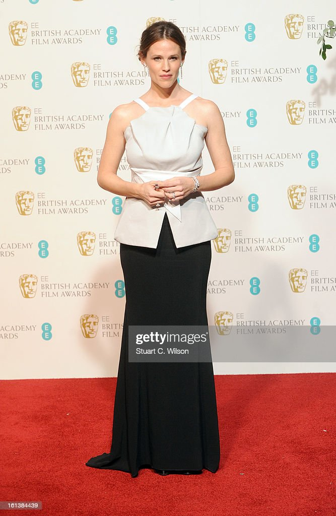 Presenter <a gi-track='captionPersonalityLinkClicked' href=/galleries/search?phrase=Jennifer+Garner&family=editorial&specificpeople=201813 ng-click='$event.stopPropagation()'>Jennifer Garner</a> poses in the press room at the EE British Academy Film Awards at The Royal Opera House on February 10, 2013 in London, England.