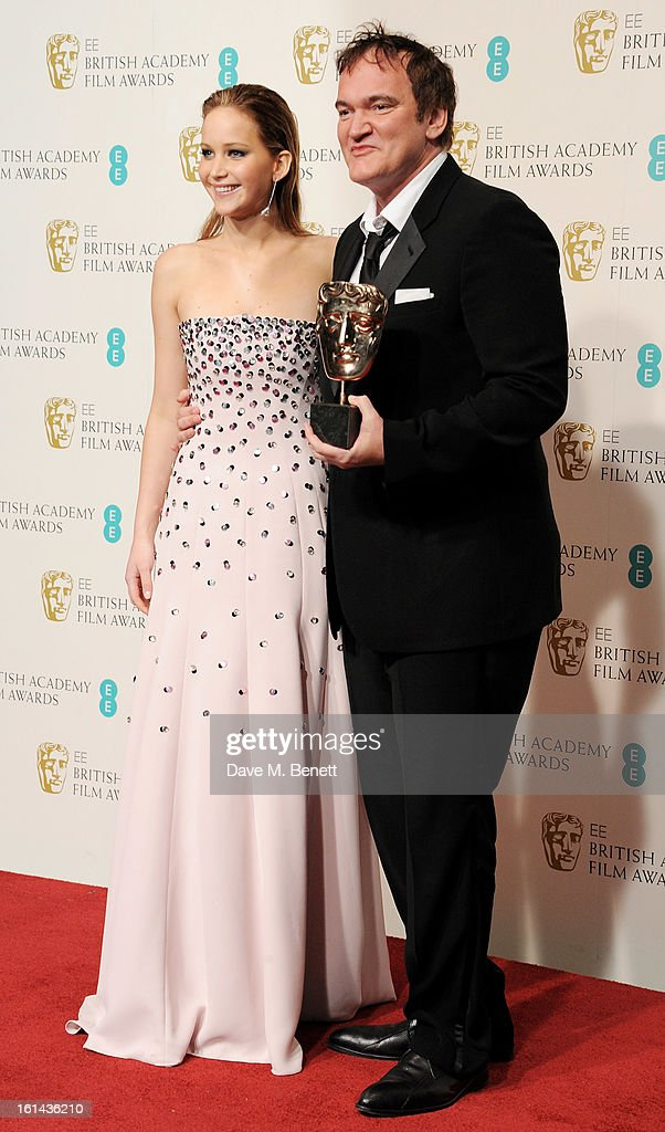 Presenter Jennifer Lawrence (L) and winner of Best Original Screenplay Quentin Tarantino pose in the Press Room at the EE British Academy Film Awards at The Royal Opera House on February 10, 2013 in London, England.