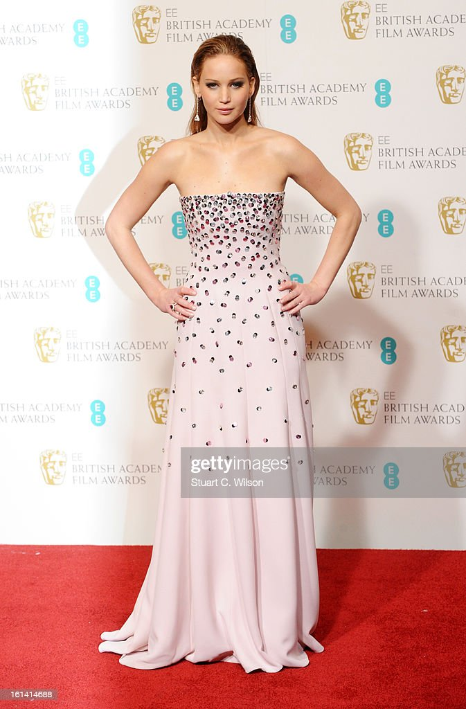 Presenter <a gi-track='captionPersonalityLinkClicked' href=/galleries/search?phrase=Jennifer+Lawrence&family=editorial&specificpeople=1596040 ng-click='$event.stopPropagation()'>Jennifer Lawrence</a> poses in the press room at the EE British Academy Film Awards at The Royal Opera House on February 10, 2013 in London, England.