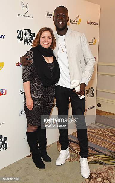 Presenter Jessica Hynes and Stormzy winner of the Times Breakthrough Award pose in the Winner's Room at the The South Bank Sky Arts Awards airing on...