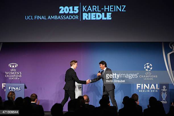 Presenter Jochen Breyer shake hands with KarlHeinz Riedle UEFA Champions League final ambassador during the UEFA Champions League Trophy handover...