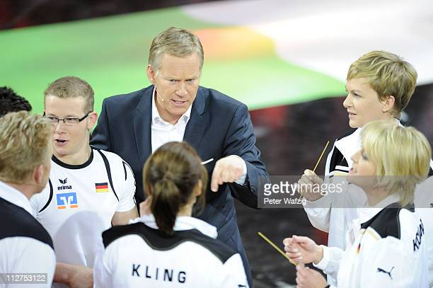 Presenter Johannes B Kerner discusses the rules with the german team members during the 'Deutschland Gegen Italien' TV Show on April 20 2011 in...