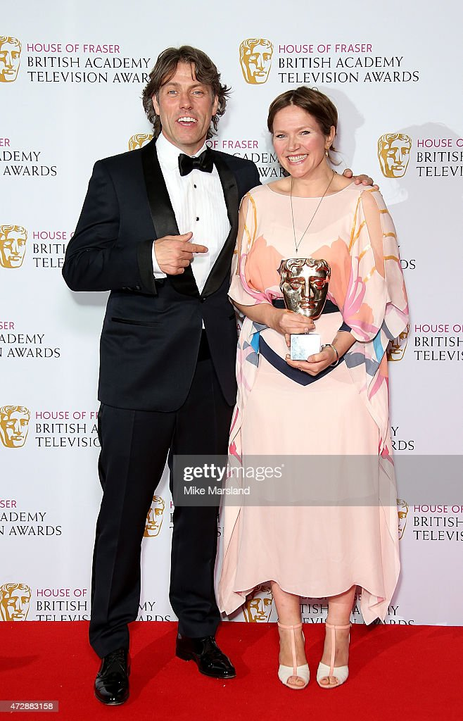 Presenter John Bishop with Jessica Hynes, winner of Best Female Performance in a Comedy Programme for 'W1A', poses in the winners room at the House of Fraser British Academy Television Awards at Theatre Royal on May 10, 2015 in London, England.