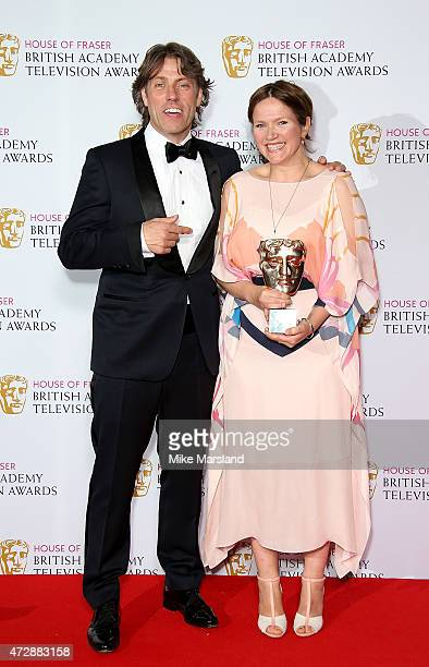 Presenter John Bishop with Jessica Hynes winner of Best Female Performance in a Comedy Programme for 'W1A' poses in the winners room at the House of...