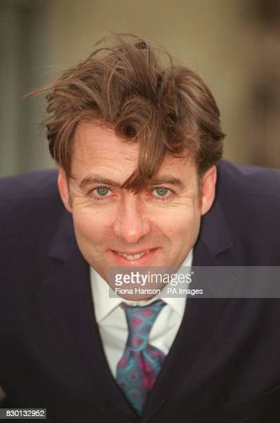 TV presenter Jonathan Ross during a photocall in Camden north London after taking delivery of his new Alabaster Vespa ET 2 scooter * 13/02/01...