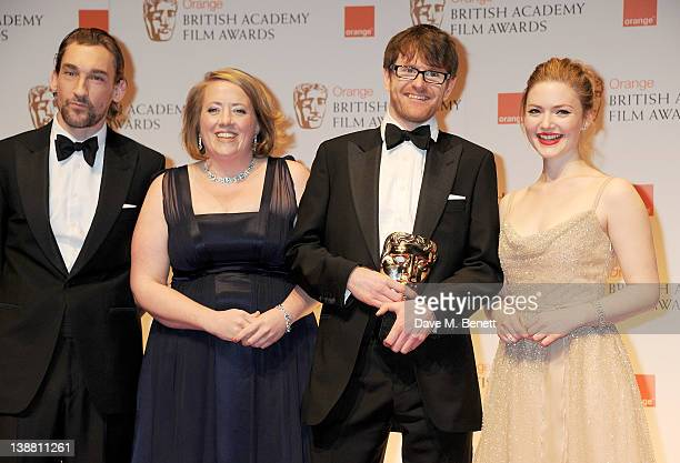 Presenter Joseph Mawle Short Film Award winners Gerardine O'Flynn and John MacLean and presenter Holliday Grainger pose in the press room at the...
