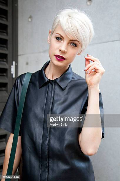 Presenter Kate Peck wears a leather top at MercedesBenz Fashion Week Australia 2015 at Carriageworks on April 12 2015 in Sydney Australia
