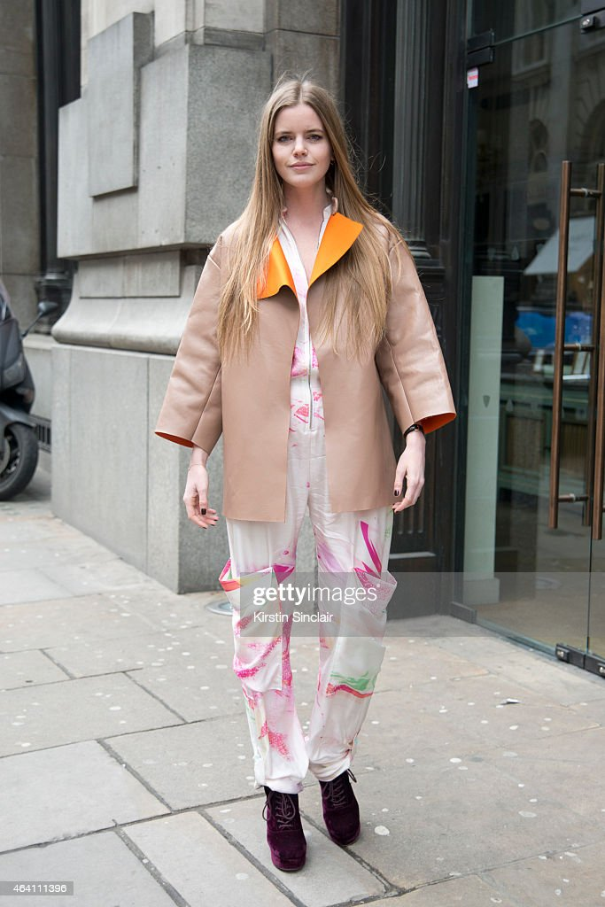 TV Presenter Katie Readman wears a Mathew Williamson jumpsuit, Topshop shoes and a Lucas Nascimento jacket on February 21, 2015 in London, England.
