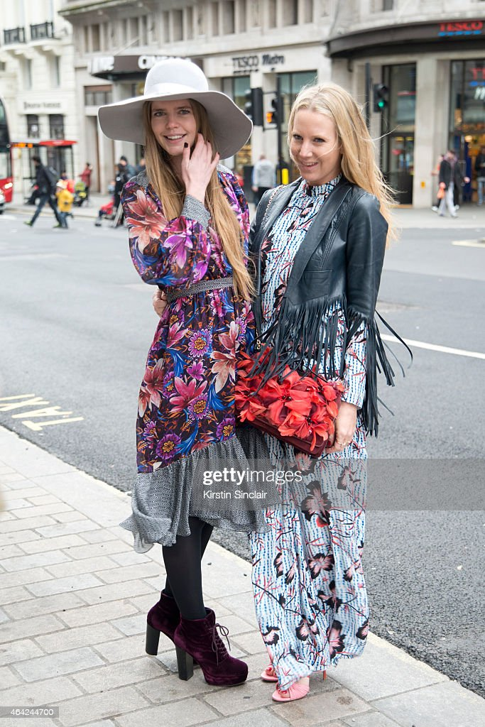 Presenter Katie Readman wears Matthew Williamson with a guest wearing Matthew Williamson on day 3 of London Collections Women on February 22 2015 in...