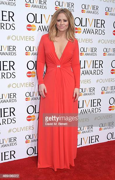 Presenter Kimberley Walsh poses in the winners room at The Olivier Awards at The Royal Opera House on April 12 2015 in London England