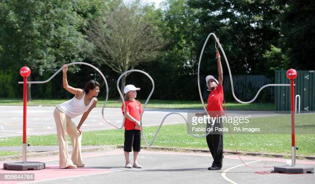 TV presenter Konnie Huq at Limbrick Wood primary school in Coventry playing on a giant pedalpowered electric buzzer game with pupils Renee Cooke...
