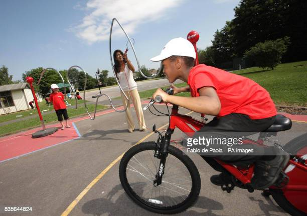 TV presenter Konnie Huq at Limbrick Wood primary school in Coventry playing on a giant pedalpowered electric buzzer game with pupils Renee Cooke left...