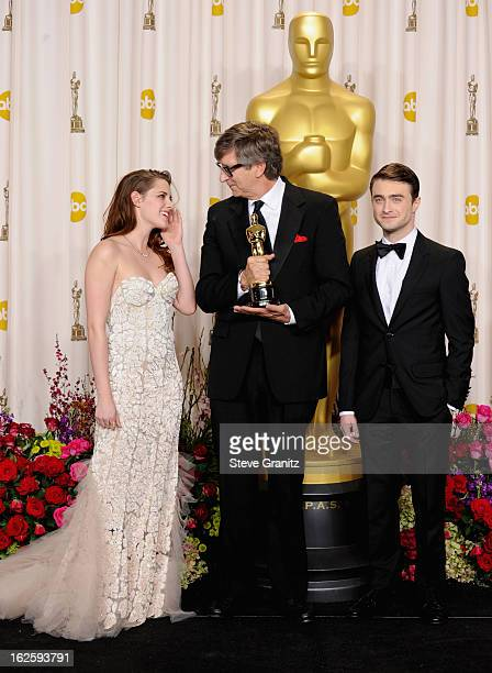 Presenter Kristen Stewart production designer Rick Carter and presenter Daniel Radcliffe pose in the press room during the Oscars at the Loews...