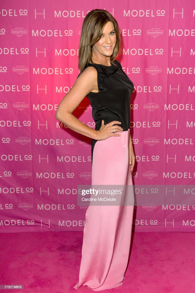 Presenter <a gi-track='captionPersonalityLinkClicked' href=/galleries/search?phrase=Kylie+Gillies&family=editorial&specificpeople=686662 ng-click='$event.stopPropagation()'>Kylie Gillies</a> arrives at a black tie dinner hosted by ModelCo on Hayman Island in celebration of their new celebrity ambassador signing, Rosie Huntington-Whiteley on July 10, 2013 in Hayman Island, Australia.
