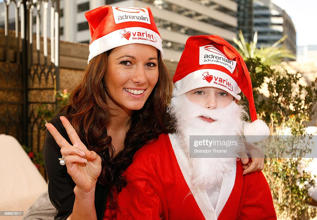 TV presenter Laura Andon poses with a girl dressed as Santa as they wait for Santas to abseil down the front of Sydney's Four Season's Hotel to launch the Sydney Santa Fun Run on August 5, 2009 in Sydney, Australia. The children's charity Variety are hosting the event on November 29 for which they hope to encourage 5000 Sydney-siders to wear a Santa suit and raise funds for disadvantaged children.