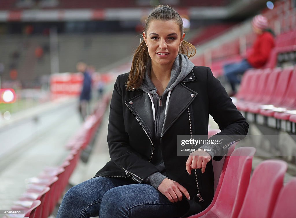 TV presenter Laura Wontorra is pictured beside the pitch at the 2nd Bundesliga match between 1. FC Koeln and Greuther Fuerth at RheinEnergieStadion on February 24, 2014 in Cologne, Germany.