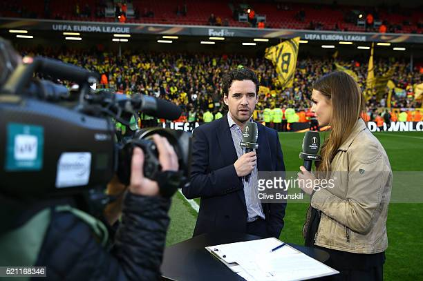TV presenter Laura Wontorra talks with Owen Hargreaves prior to the UEFA Europa League quarter final second leg match between Liverpool and Borussia...