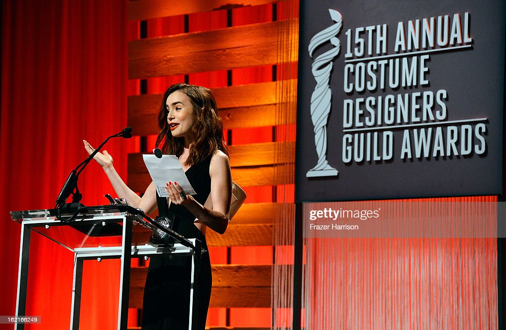 Presenter <a gi-track='captionPersonalityLinkClicked' href=/galleries/search?phrase=Lily+Collins&family=editorial&specificpeople=3520243 ng-click='$event.stopPropagation()'>Lily Collins</a> speaks onstage during the 15th Annual Costume Designers Guild Awards with presenting sponsor Lacoste at The Beverly Hilton Hotel on February 19, 2013 in Beverly Hills, California.