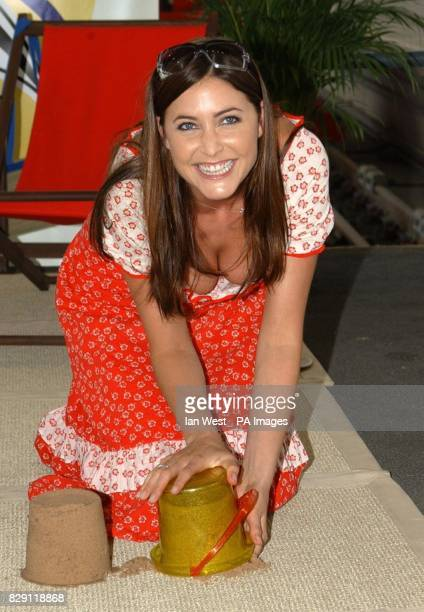 TV presenter Lisa Snowdon makes sandcastles during a photocall to launch the National Express Group's Great Rail Getaway Giveaway at St Pancras...