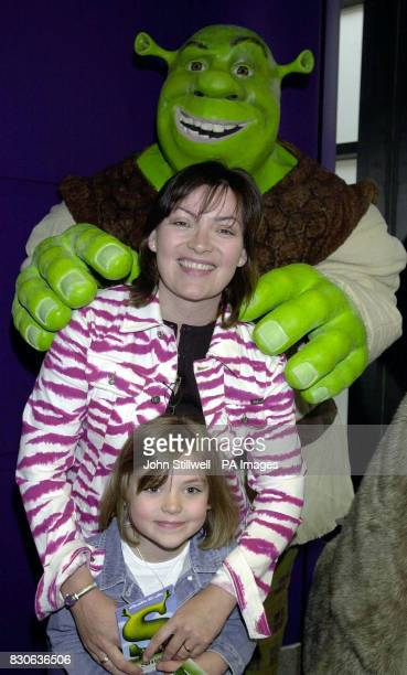 TV presenter Lorraine Kelly and daughter Rosie aged seven get a hug from the star of Shrek the new animated film from the Dreamworks studio at a...