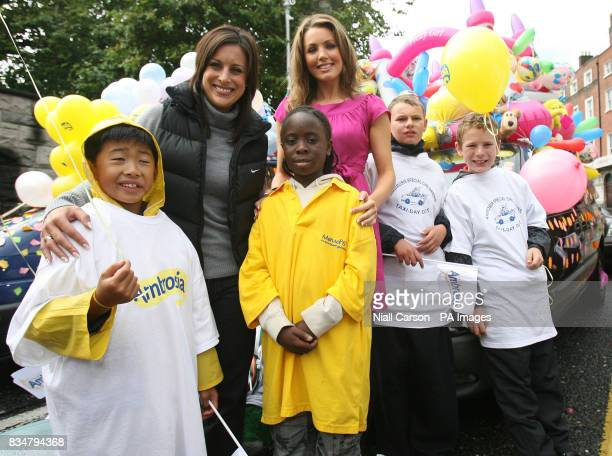 TV presenter Lucy Kennedy left and Miss Ireland Sinead Noonan right join pupils from St Paul's Special School in Parnell Square Dublin for the 49th...