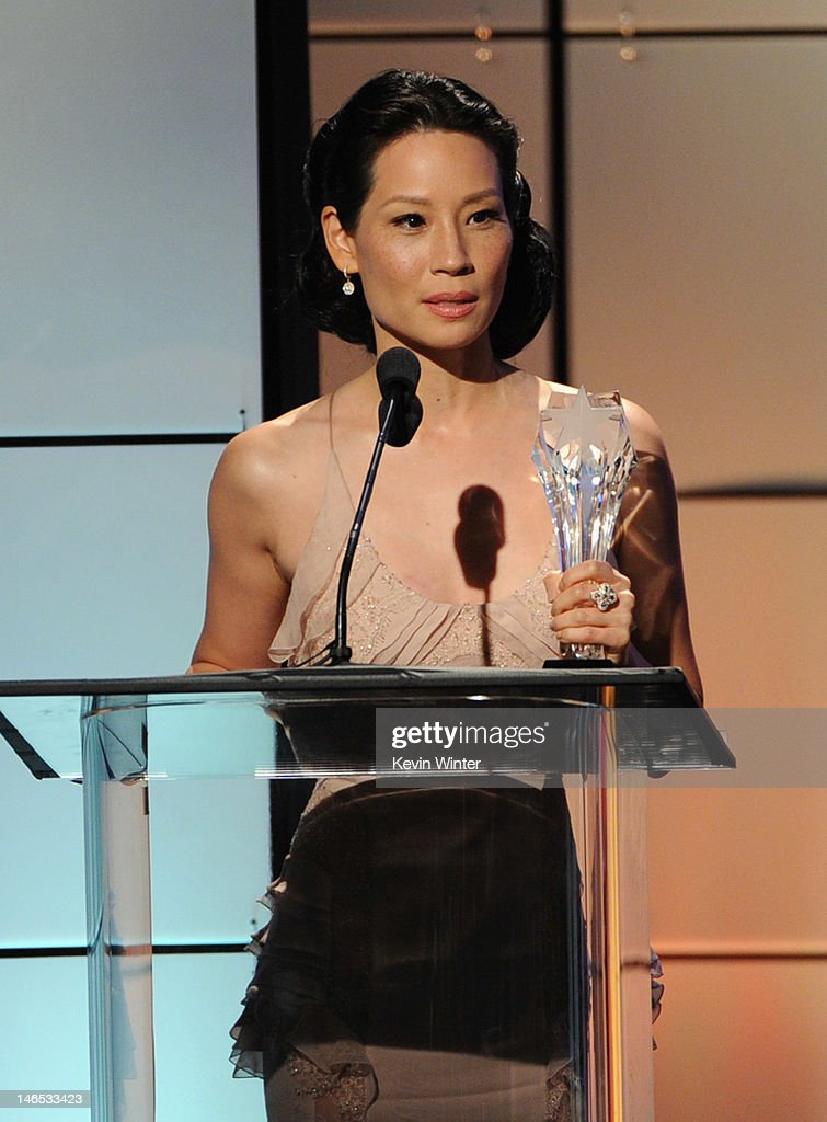 Presenter Lucy Liu accepts the award for Best Reality Show Host on behalf of Tom Bergeron onstage during The Broadcast Television Journalists Association Second Annual Critics' Choice Awards at The Beverly Hilton Hotel on June 18, 2012 in Beverly Hills, California.