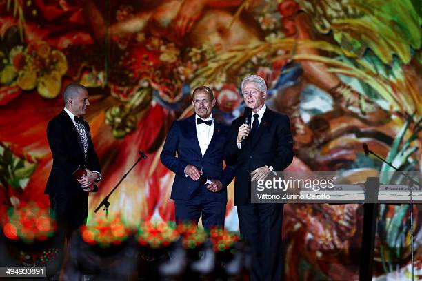 Presenter Manuel Rubey Life Ball founder Gery Keszler and Bill Clinton are seen on stage during the Lifeball 2014 at City Hall on May 31 2014 in...