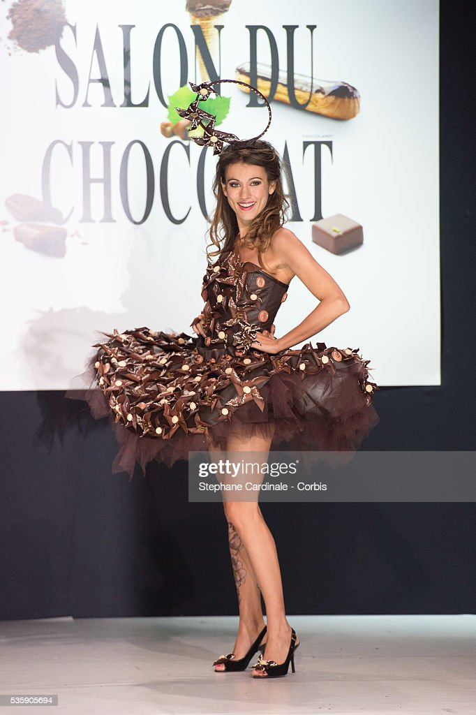 TV presenter Marie-Ange Casalta walks the runway and wears 'Divine Zephyrine' a chocolate dress made by designer Manon Bresson-Cancel and chocolate makers Jean-Marc Rue and Keiko Orihara during the Fashion Chocolate Show at Salon du Chocolat at Porte de Versailles, in Paris.