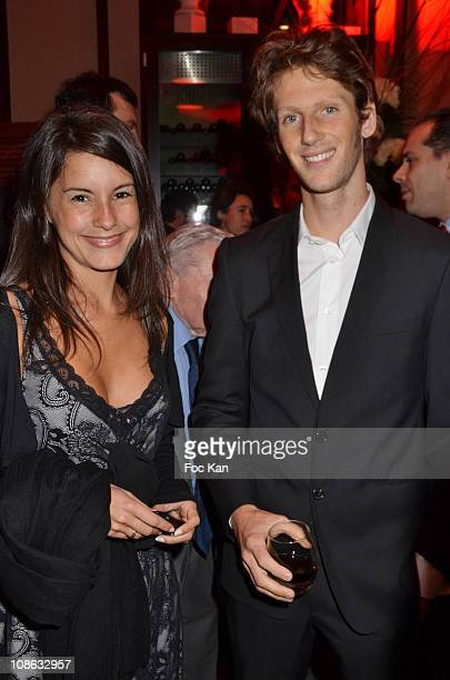 TV presenter Marion Jolles and formule 1 racer Romain Grosjean attends the Pirelli 2011 Calendar Launch at the Mini Palais on January 13 2011 in...