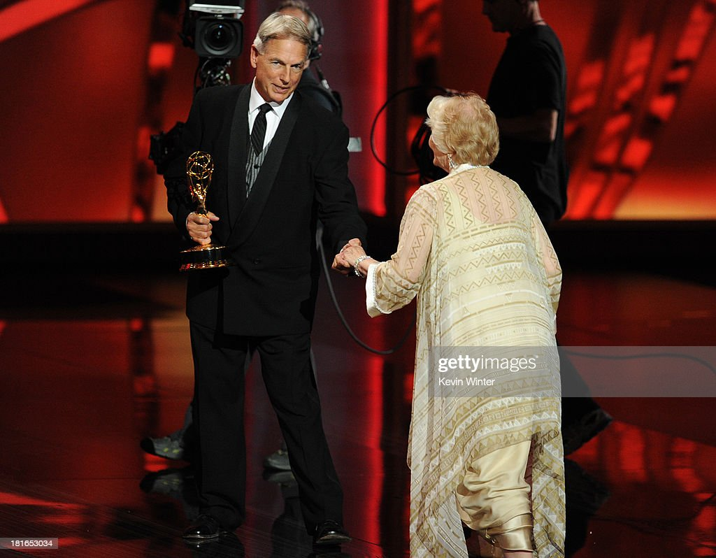 Presenter Mark Harmon and Outstanding Supporting Actress in a Miniseries or Movie winner, Ellen Burstyn, onstage during the 65th Annual Primetime Emmy Awards held at Nokia Theatre L.A. Live on September 22, 2013 in Los Angeles, California.