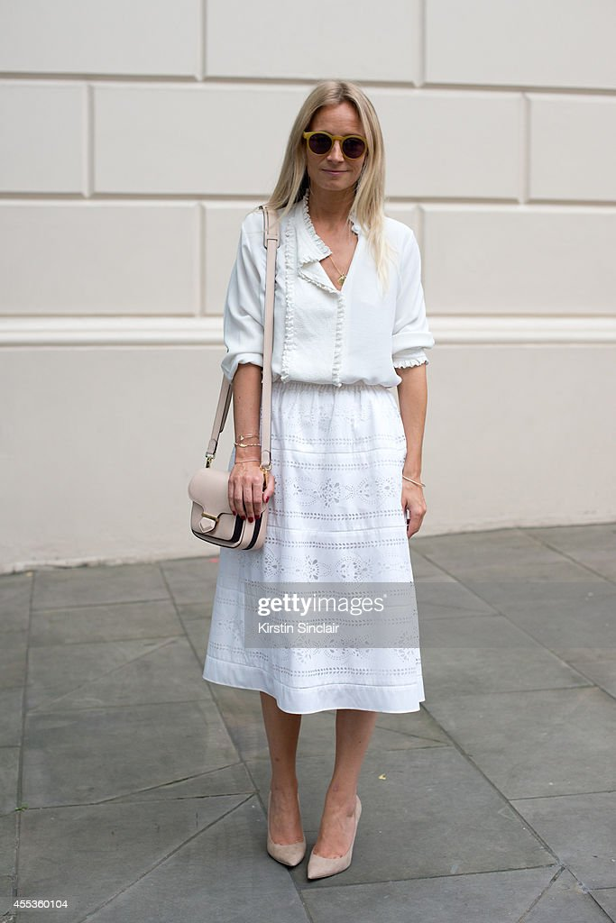 Presenter Martha Ward is wearing a Vilshenko blouse Todds bag Madewell sunglasses J Crew skirt and Jimmy Choo shoes on day 1 of London Collections...