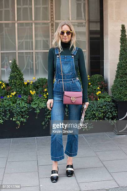 TV presenter Martha Ward wears H and M dungarees Club Monaco top Topshop shoes and a Gucci bag on day 5 during London Fashion Week Autumn/Winter...