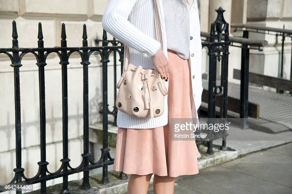 Presenter Martha Ward wears Iris and Ink jumper and skirt Bamford cardigan and a Tods Boutique bag on day 3 of London Collections Women on February...