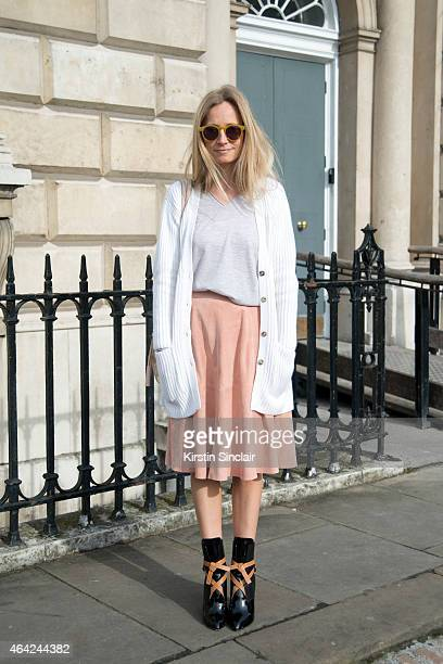 Presenter Martha Ward wears Iris and Ink jumper and skirt Bamford cardigan Louis Vuitton boots and a Tods Boutique bag on day 3 of London Collections...