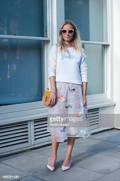 TV presenter Martha Ward wears Nicholas Kirkwood shoes Alexander Lewis sweater and skirt Chloe bag and Zanzan sunglasses on day 2 during London...